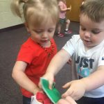 Toddlers working on gross motor skills
