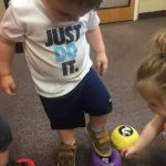 Toddlers learning gross motor skills and cognitive development