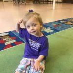 Baby girl learning body awareness