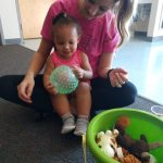 Teacher and toddler ball skills