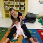 Teacher and toddler stretching