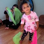 Toddlers dancing with scarves