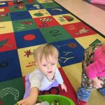 Babies practicing gross motor skills