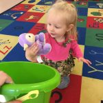 Babies learning gross motor skills