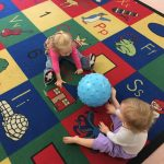 Toddlers learning ball skills