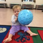 Toddler learning ball skills