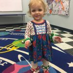 Toddler dancing with jingle bells