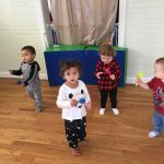 Toddlers dancing with maracas